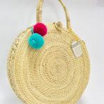 Bolsos Palma de Iraca Forma Disco Asa Corta Borlas Wayuu